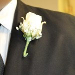 Ivory rose and baby breath boutonniere