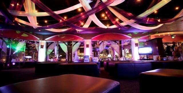 Purple and white ceiling drape at Jackson