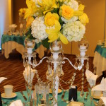 white and yellow candelabra centerpice