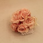 Corsages with pink spray roses with peal bracelet