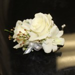 white roses with orchid corsage