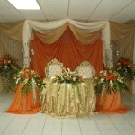 orange abd gold stage decorations